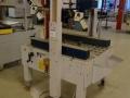 Автоматична машина за запечатване на кашони с тиксо