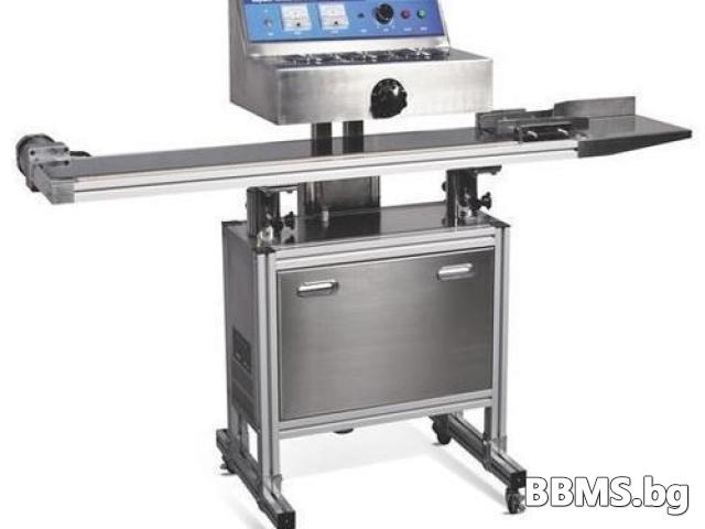 Автоматична машина за индукционно запечатване на шишета с алуминиево фолио.