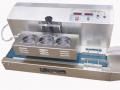 Затваряща машина с електромагнитна индукция